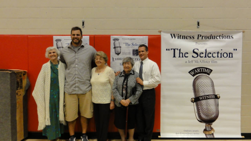 Former University of Wisconsin offensive lineman, Gabe Carimi, hosted the Meeting History tour in his hometown of Cottage Grove, Wisconsin and welcomed Auschwitz survivors Eva Fahidi, Magda Brown and Erzsebet Szemes.  He gave the opening remarks and welcomed the creator of the Wartime Witness documentary Wartime Witness